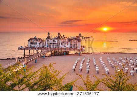 Famous Sellin Seebruecke (sellin Pier) In Beautiful Golden Morning Light At Sunrise In Summer, Ostse