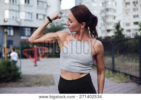 Young Sportswoman Shows Her Muscles, Has Training In Gym Every Day. People, Wellbeing And Lifestyle