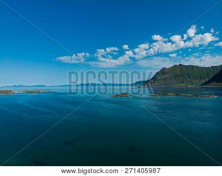 Coast Of Gimsoya Island In Summertime. Sea With Mountains. Nordland County, Lofoten Archipelago Norw