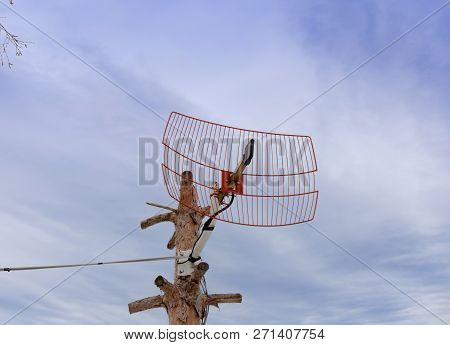 Satellite Tv House Antena With Cloudy Natural Sky Background