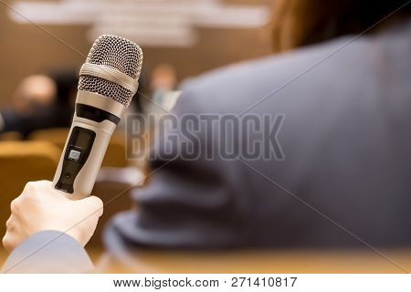 Hands Business People Holding Microphones For Speech Or Speaking In Seminar Room, Talking For Lectur