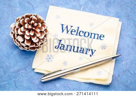 Welcome January -  handwriting on a napkin with a frosty pine cone