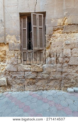 Broken Windows And Grunge Stone Bricks Wall In Abandoned Darb El Labana District, Cairo, Egypt