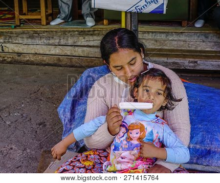 Taunggyi, Myanmar - Feb 8, 2018. A Woman With Her Daughter In Taunggyi, Myanmar. Since 1962, Myanmar