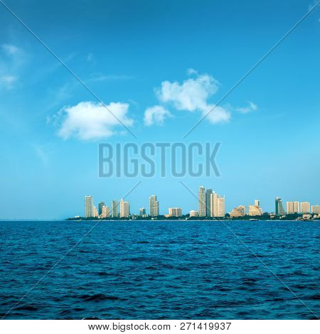 cityscape of modern architecture buildings with blue sea water over blue clear sky in downtown Pattaya, Thailand