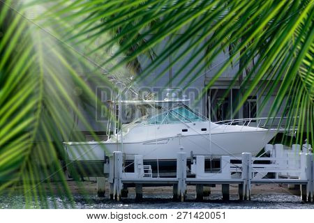 Close up parked boat at dock on canal in Florida, USA
