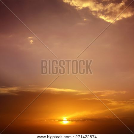 Beautiful cloudscape of colorful sunset sky with shining sun