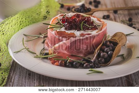 Whole Camembert Wrapped In Dry Ham With Cranberries On Top
