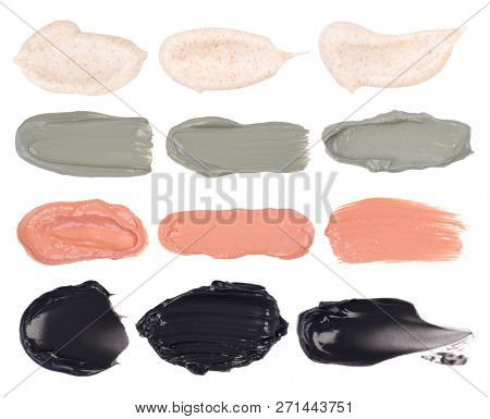 Cosmetic masks smears. Moisturizing, peeling, clay and charcoal masks isolated on a white background.