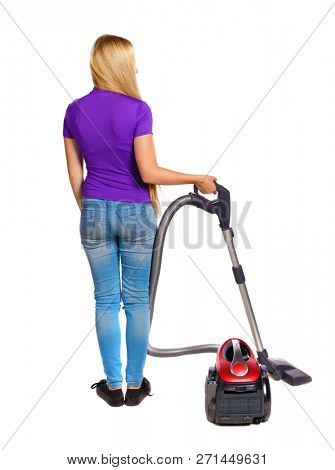 Rear view of a woman with a vacuum cleaner. She is busy cleaning. Rear view people collection.  backside view of person.  Isolated over white background. Housewife cleaned the house
