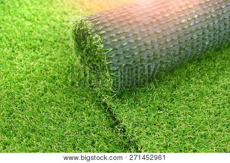 Artificial Turf Laying Background. Roll Of An Synthenic Grass Layer. Greenering Of The Yard With An