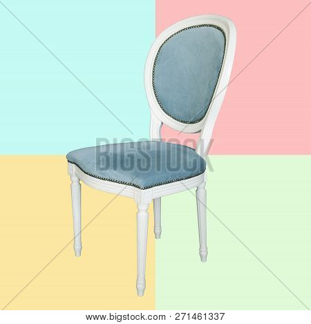 An Antique White Chair With A Blue Upholstery Isolated On Color Background. Retro Style. Furniture F