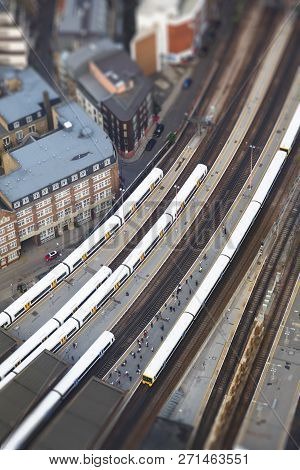London, Uk - July 03, 2013. Aerial View Of Commuters Waiting For A Train On The Platform Of London B
