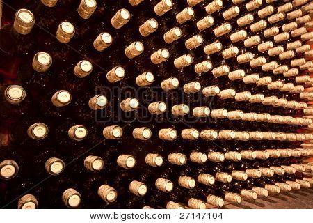 stacked up wine bottles in the cellar