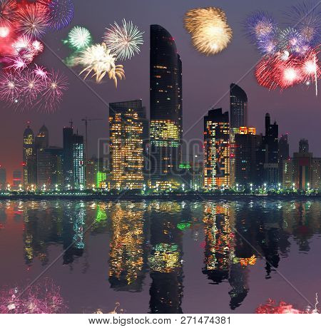 Abu Dhabi With Skyscrapers Against Fireworks In United Arab Emirates