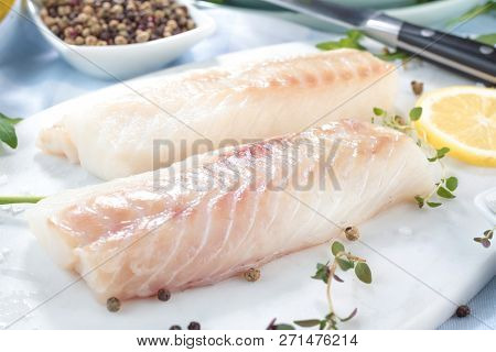 Fresh Fish, Raw Cod Fillets With Addition Of Herbs And Lemon.
