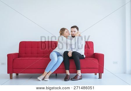 Wife Reconcile Her Touchy Husband And Hugging Couple In Love At The Living Room,positive Attitude Em
