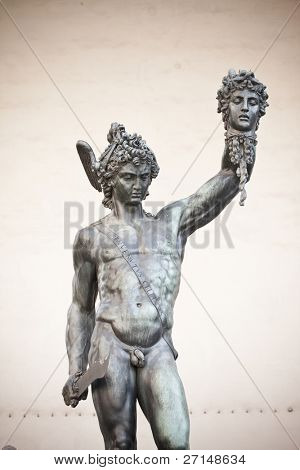 bronze statue of Perseus holding the head of Medusa