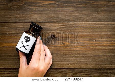 Dangerous Addictions, Dangerous Entertainment. Poison. Female Hand Hold Bottle With Skull And Crossb