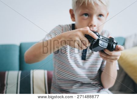 poster of Little boy playing video games