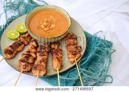 Chicken Satay Or Sate Ayam - Indonesian Food. Skewered And Grilled Meat, Served With A Peanut Sauce.