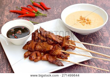 Sate Ayam Or Chicken Satay - Indonesian Food. Served With Peanut Sauce, Thick Sweet Soy Sauce And Ch