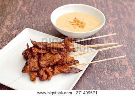 Sate Ayam Or Chicken Satay - Indonesian Food. Served With Peanut Sauce