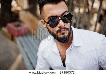 Close Up Photo Of Stylish Arabian Man Model In White Shirt And Sunglasses. Beard Attractive Arab Guy