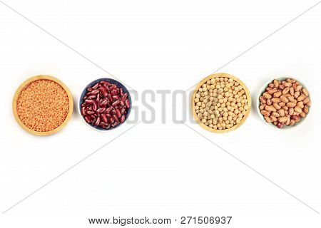 Various Types Of Pulses, Shot From Above On A White Background With Copy Space. Kidney And Pinto Bea
