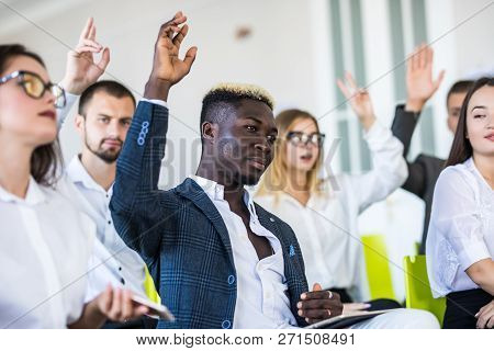 Group Of Business People Raise Hands Up To Agree With Speaker In The Meeting Room Seminar. Business