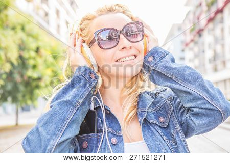 A Smiling Woman Listen Music With Headphone