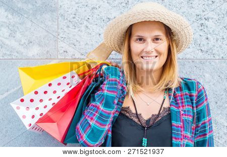 Shopping Time: Woman With Colored Shopping Bags