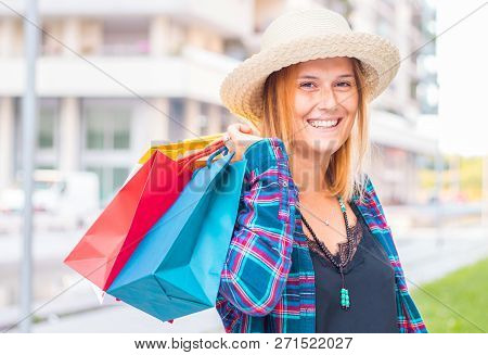 A Shopping Time: Woman With Colored Shopping Bags