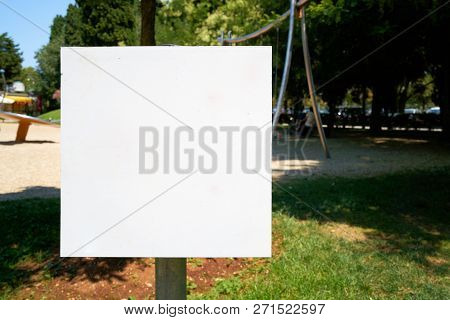 Empty White Signboard At A Public Park