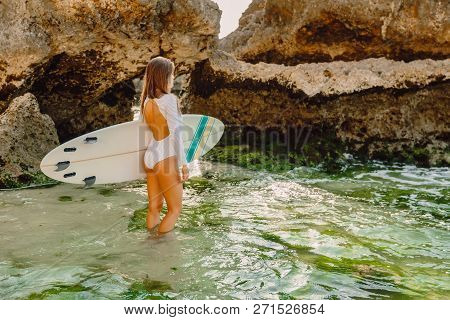 Surf Woman With Surfboard Going To Ocean For Surfing.