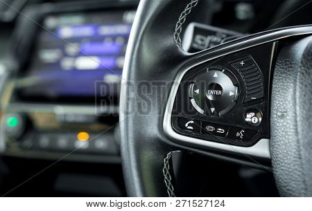 Transportation Vehicle And Car Cruise Control Concept - Close Up Car Cruise Control On Car Steering