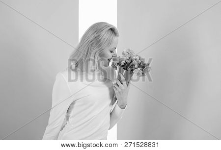 Feeling So Special. Girl Holding Bouquet Flowers Enjoy Favorite Fragrance. Woman Smiling Likes To Fe