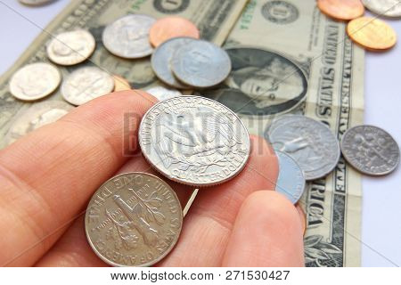 Close Up American Quarter, Dime Coins In Hand On Dollar Usa Background