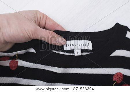 Kharkov, Ukraine- November 07, 2018: White Label Warehouse In Female Hand.  Close Up. Fashion Concep