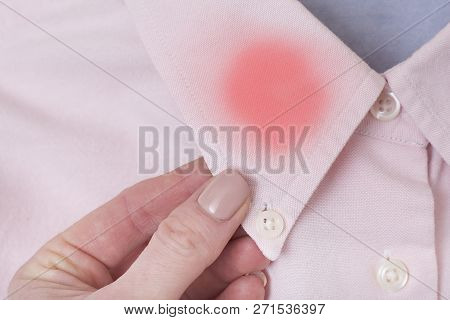 Collar Of Pink Shirt In Female Hand. Fashionable Concept