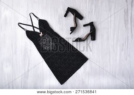 Kharkov, Ukraine- November 07, 2018: Black Nightie And Shoes On A Wooden Background. Fashion Concept