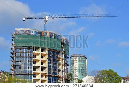 Construction Of A New Office Building At A Summer Dat
