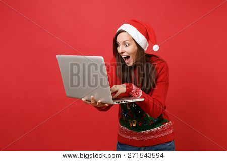 Excited Santa Girl Keeping Mouth Wide Open Looking Surprised Working Typing On Laptop Pc Computer Is