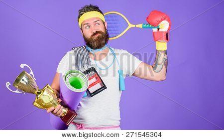 Sport Shop Assortment. Man Bearded Athlete Hold Sport Equipment Jump Rope Fitness Mat Boxing Glove E