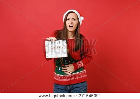 Exhausted Santa Girl Holding Female Periods Calendar For Checking Menstruation Days Isolated On Red
