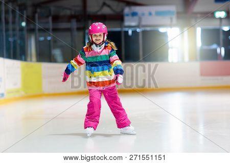 Child Skating On Indoor Ice Rink. Kids Skate.