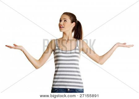 Front view portrait of a beautiful young female caucasian teen looking up and spreading her arms, on white.
