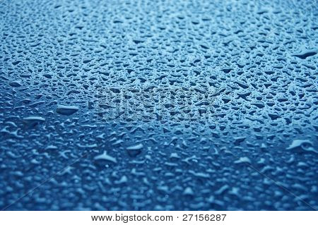Water droplets on glass. Raindrops.