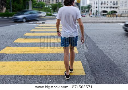 Young Man On Pedestrian Crossing, Back View. Busy City Street, Concept Of Pedestrian Safety On The R