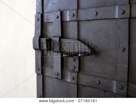 The lock on the old metal door